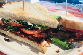 Applewood smoked bacon, fresh tomato, mesclun greens and mayonnaise served on toasted sour dough