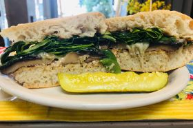 Portabello mushroom with swiss cheese warmed on ciabatta with garlic mayo, spinach and balsamic vinaigrette