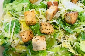 Romaine lettuce tossed with romano and parmesan cheese and topped with house made croutons