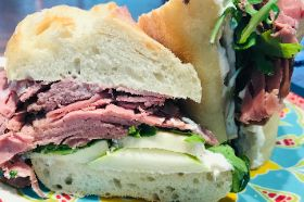 Boars Head Roast Beef with brie, green apple, arugula and horseradish mayo on baguette